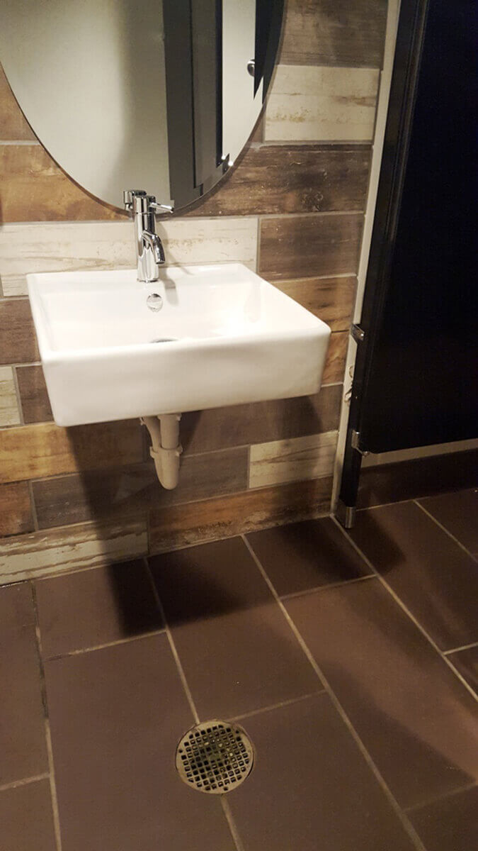 Photo Album View Jay R Smith MFG Co - Bathroom floor drain installation
