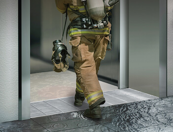 Fire fighter entering elevator